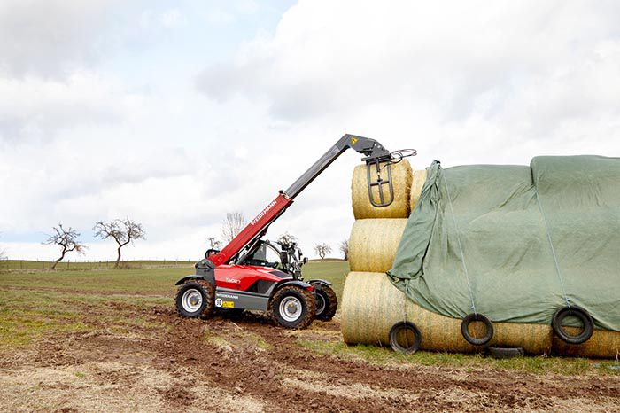 Weidemann telehandler T6027 with round bale fork action 1