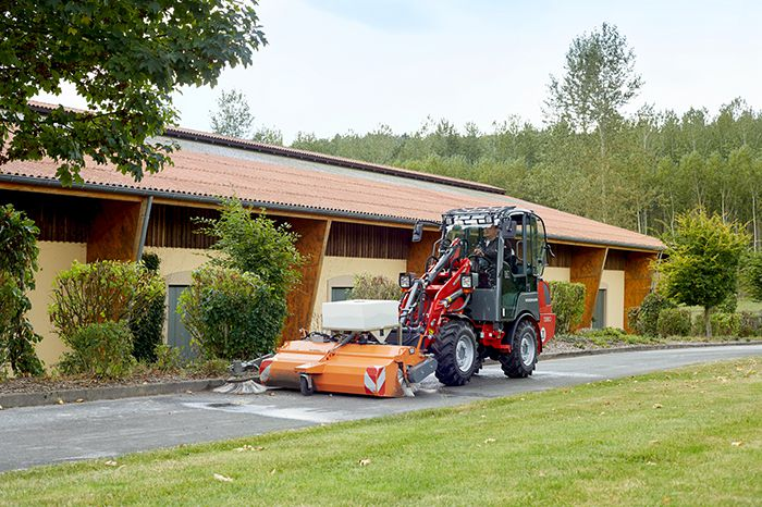 Weidemann Hoftrac 1380 cabin application with rotary sweeper