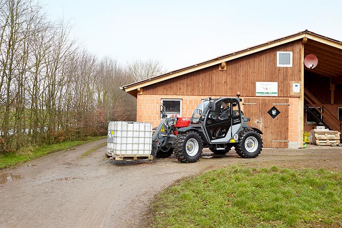 Weidemann telehandler T6027 with pallet fork action 1