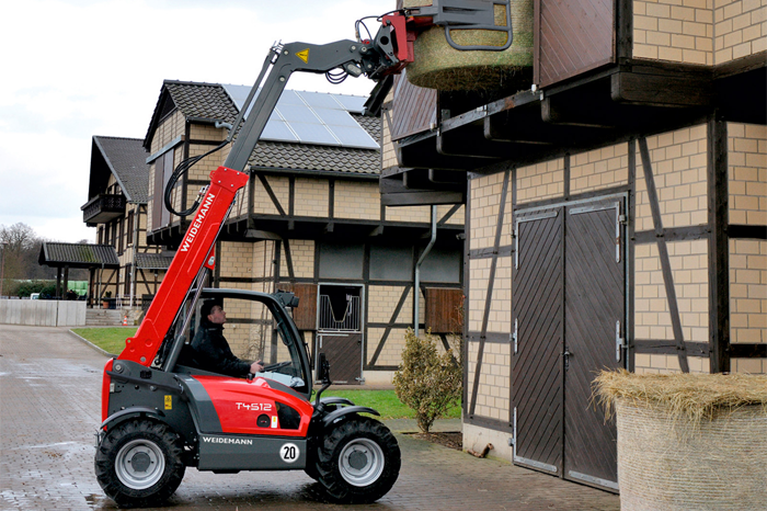 Weidemann telehandler T4512 application with round bale fork